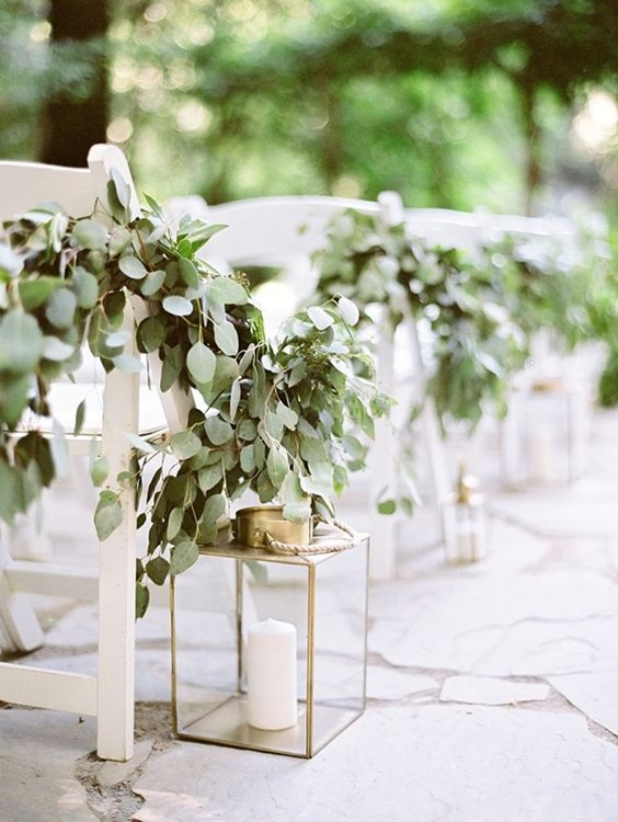 eucalyptus garlands and lanterns for decorating the aisle