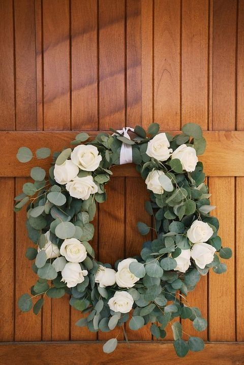 eucalyptus and white roses wedding wreath is a romantic decoration