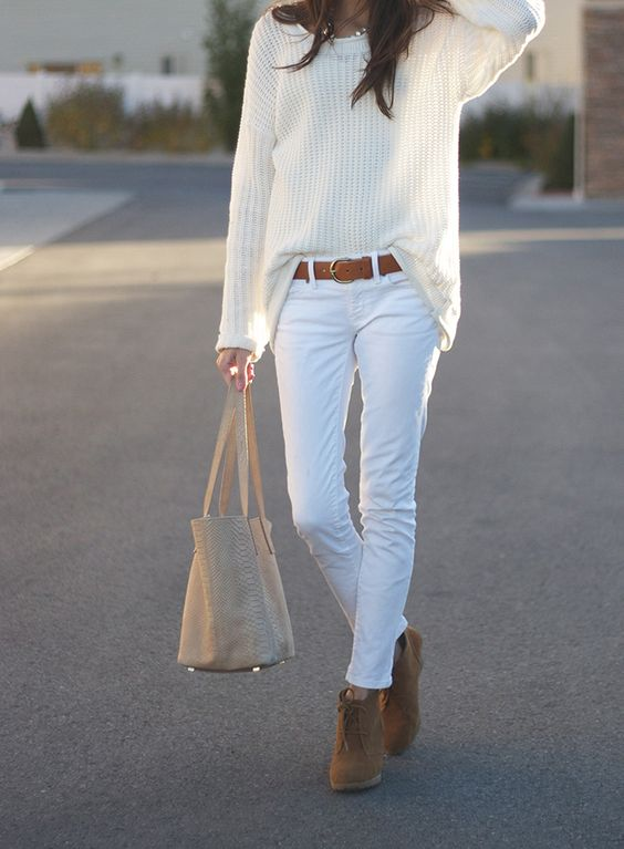 white denim, a white chunky sweater and ocher boots