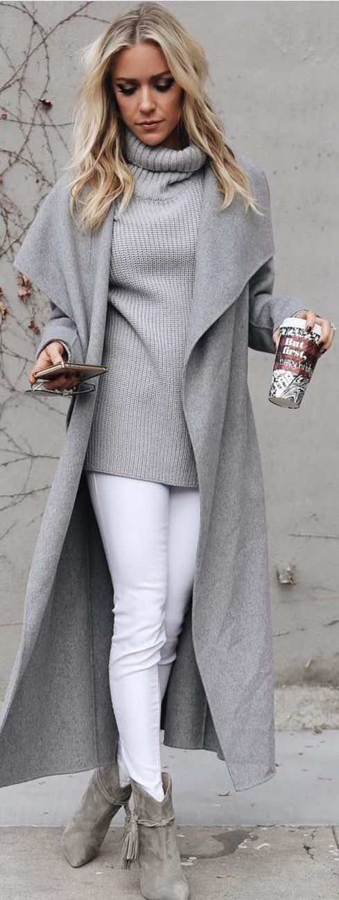 white jeans, grey ankle boots, a grey sweater and a long coat