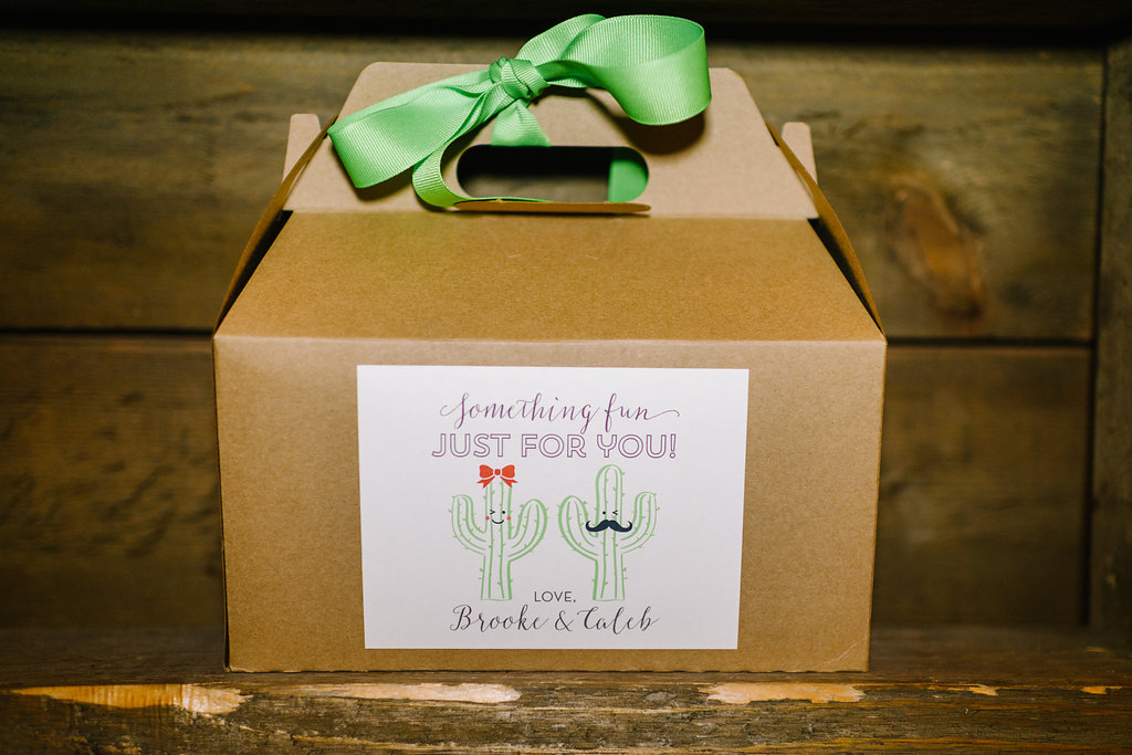 wedding favor boxes - photo by Cathrine Taylor Photography http://ruffledblog.com/colorful-alabama-wedding-with-desert-accents
