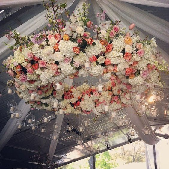 hydrangeas, roses, tulips and branches unite in this spectacular hanging wreath with tealight candles