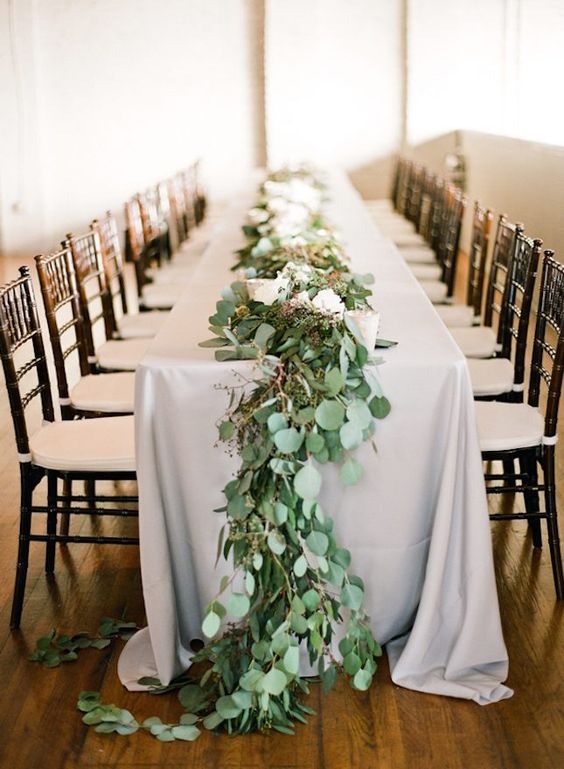 eucalyptus table garland with berries can substitute any centerpiece