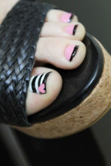 pink and black nail art with stripes