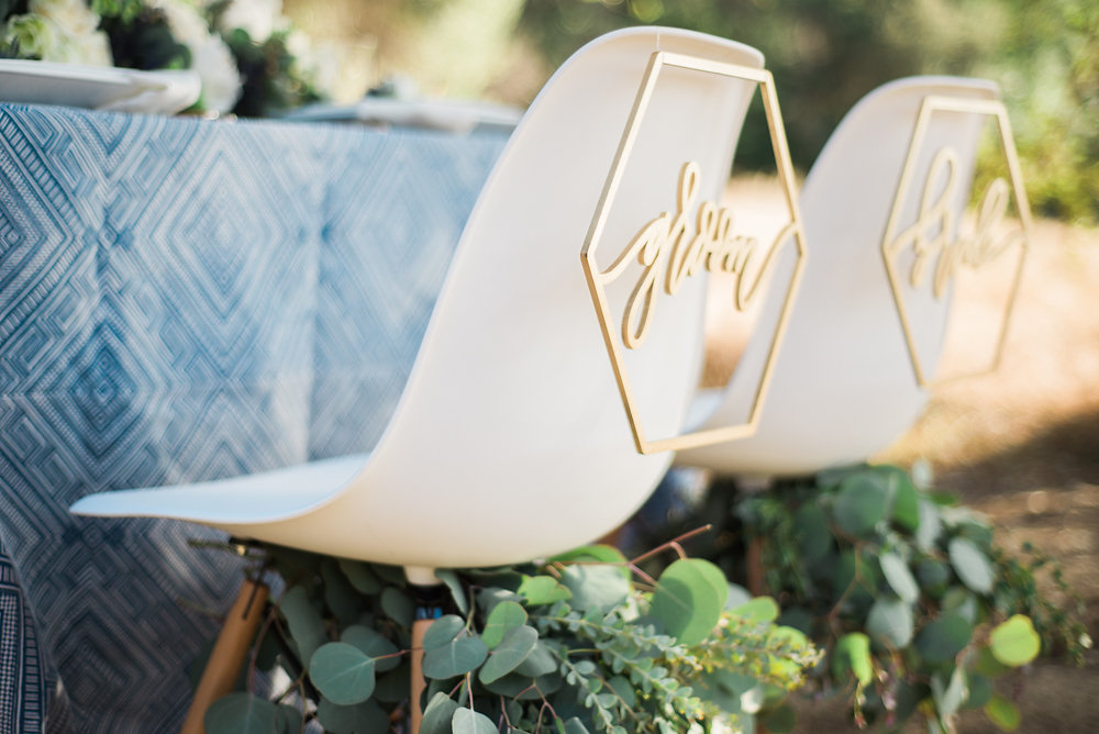 wedding chair signs - photo by Anya Kernes Photography http://ruffledblog.com/organic-wedding-inspiration-with-shades-of-blue