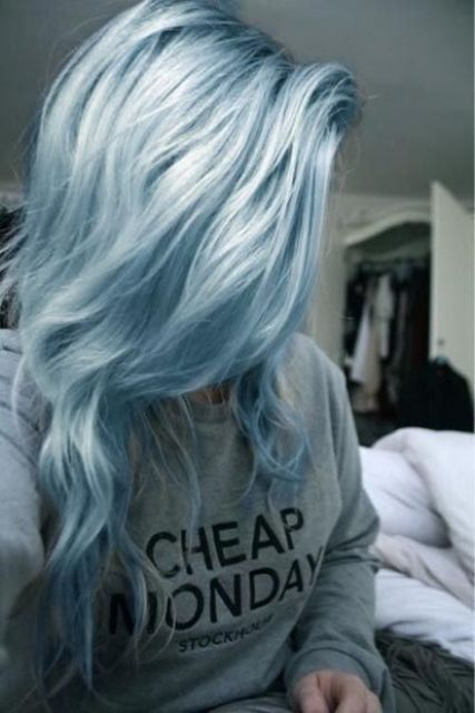 soft and light blue color with darker roots