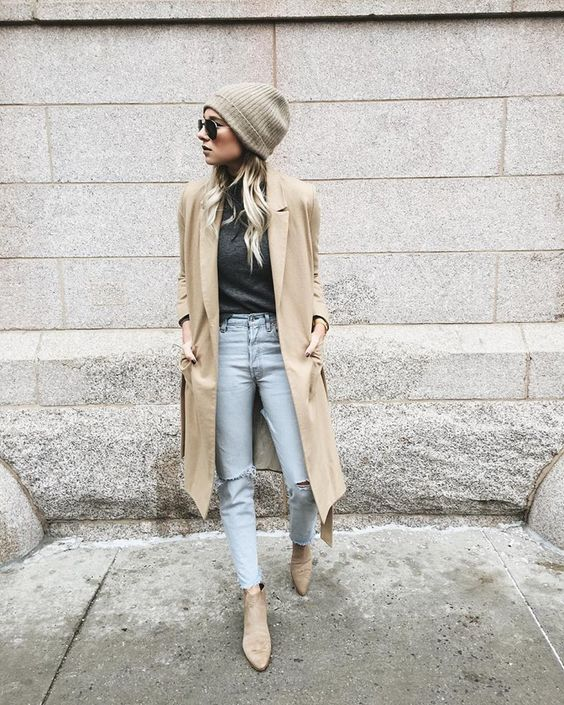 distressed jeans, a black tee, a camel coat and flat boots