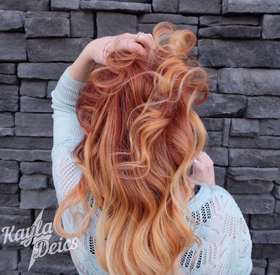 firery red hair with balayage nude blonde ends
