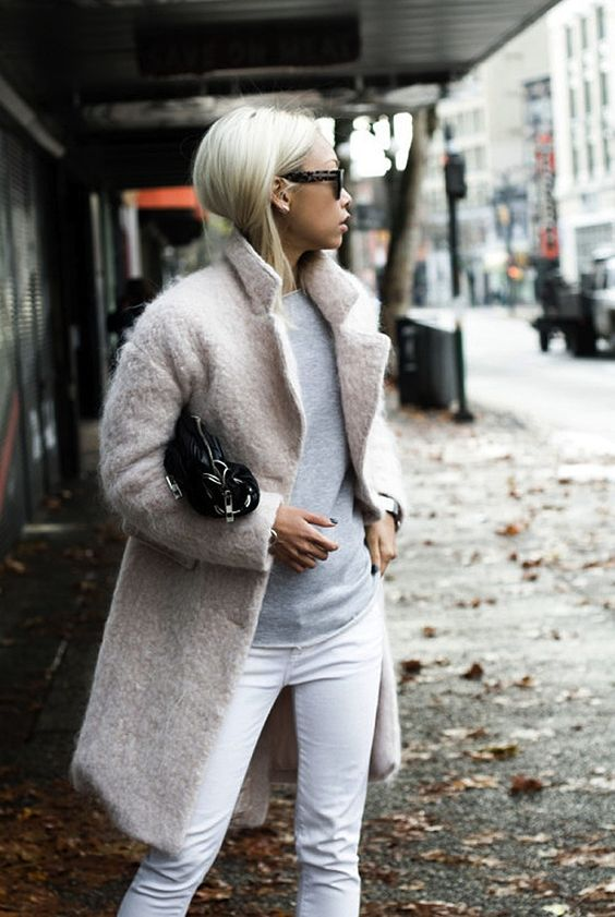 white jeans, a grey sweater and a blush coat
