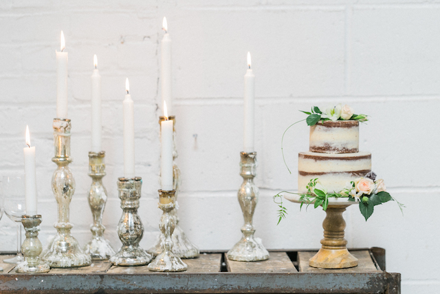 Neutral luxe cake display with candles | ©AlexisJuneWeddings | NYC + Destination Wedding Photographer