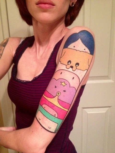 Colorful Adventure Time themed tattoo