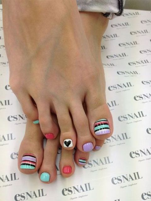 whimsy colorful pedicure wwith stripes and hearts