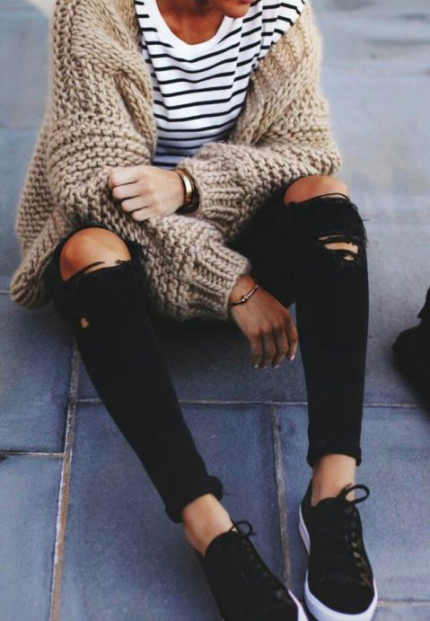 striped tee, an oversized beige cardigan, ripped black jeans and chucks