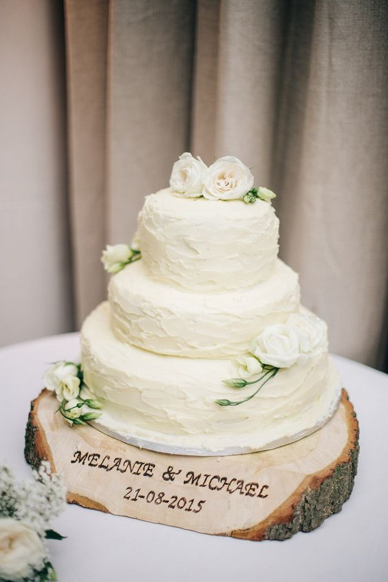 large wood slice for the wedding cake, with names and a date