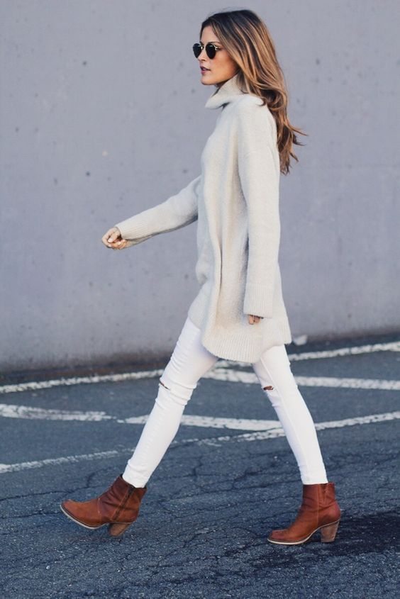 white ripped jeans, a white oversized turtleneck sweater