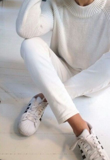 white denim, a white sweater and chucks for a minimal look