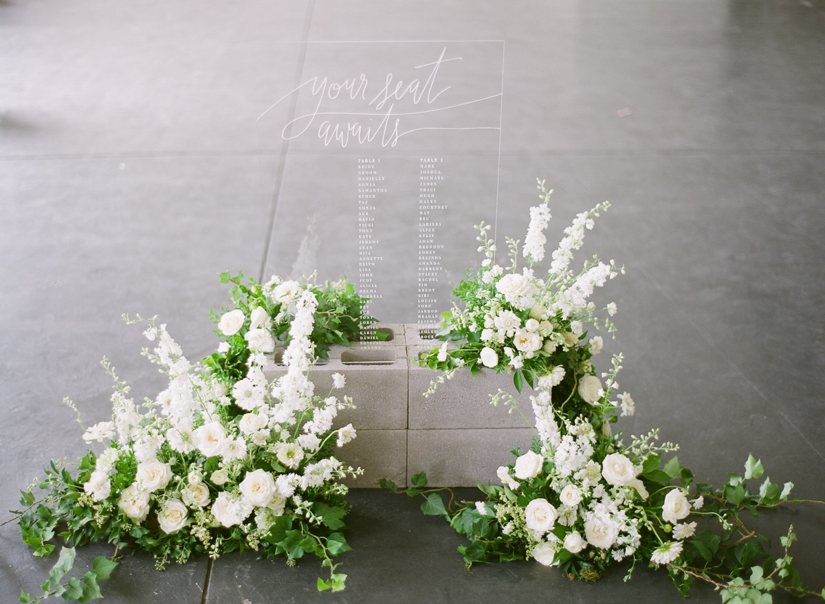 modern wedding seating charts - photo by Qlix Photography http://ruffledblog.com/wedding-elegance-with-understated-beauty