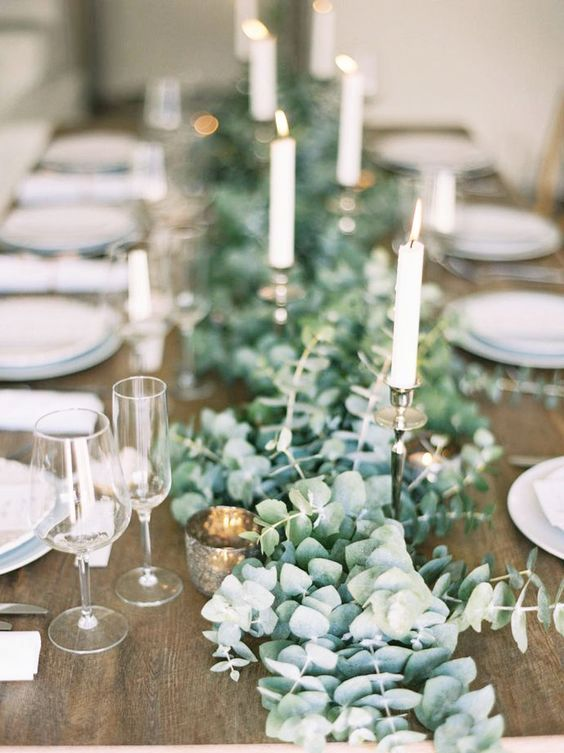 lush eucalyptus table garland with candles