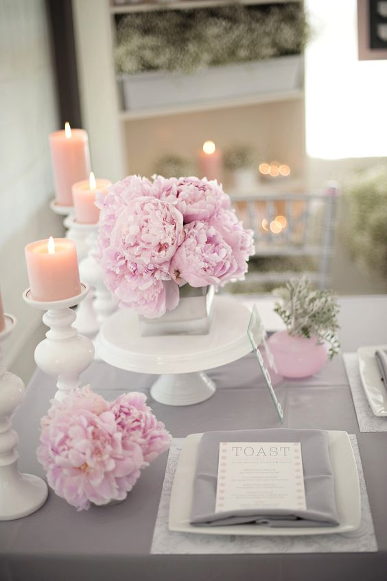 grey fabrics and pink florals and candles for the table decor