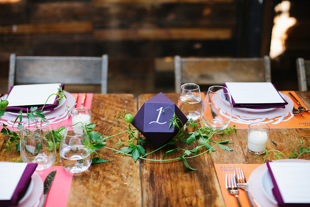 table numbers - photo by Levi Stolove Photography http://ruffledblog.com/botanical-wedding-with-a-mint-green-wedding-dress