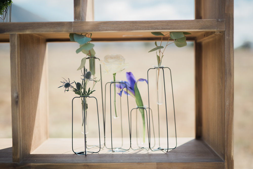 unique vases - photo by Anya Kernes Photography http://ruffledblog.com/organic-wedding-inspiration-with-shades-of-blue