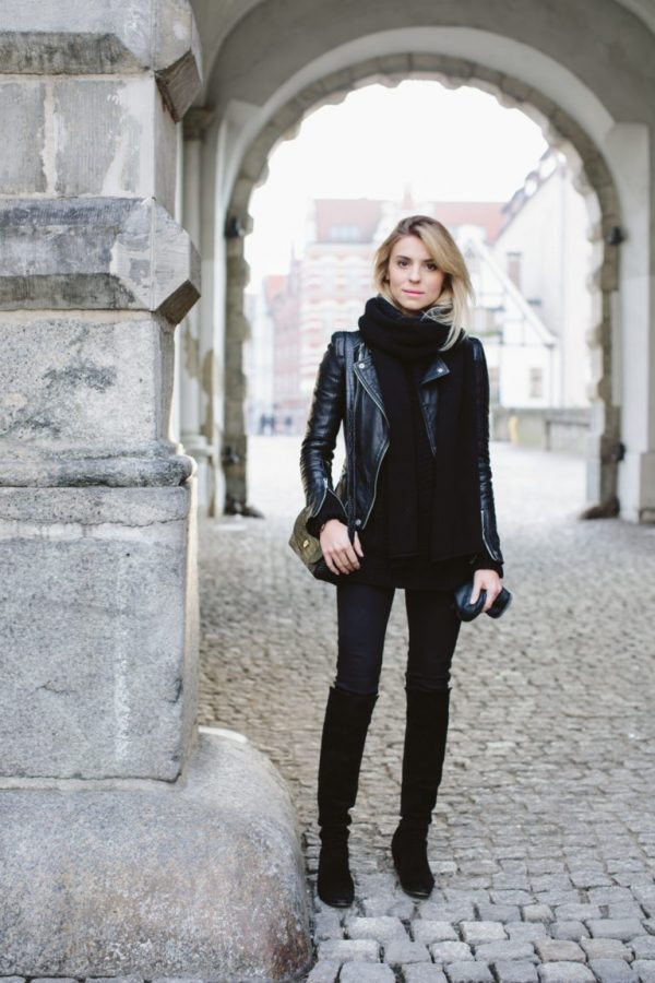 black denim, suede flat boots, a sweater and a scarf with a leather jacket