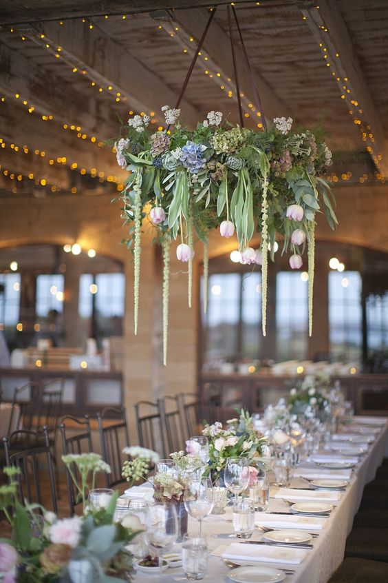 greenery and tulips chandelier hanging over the tables