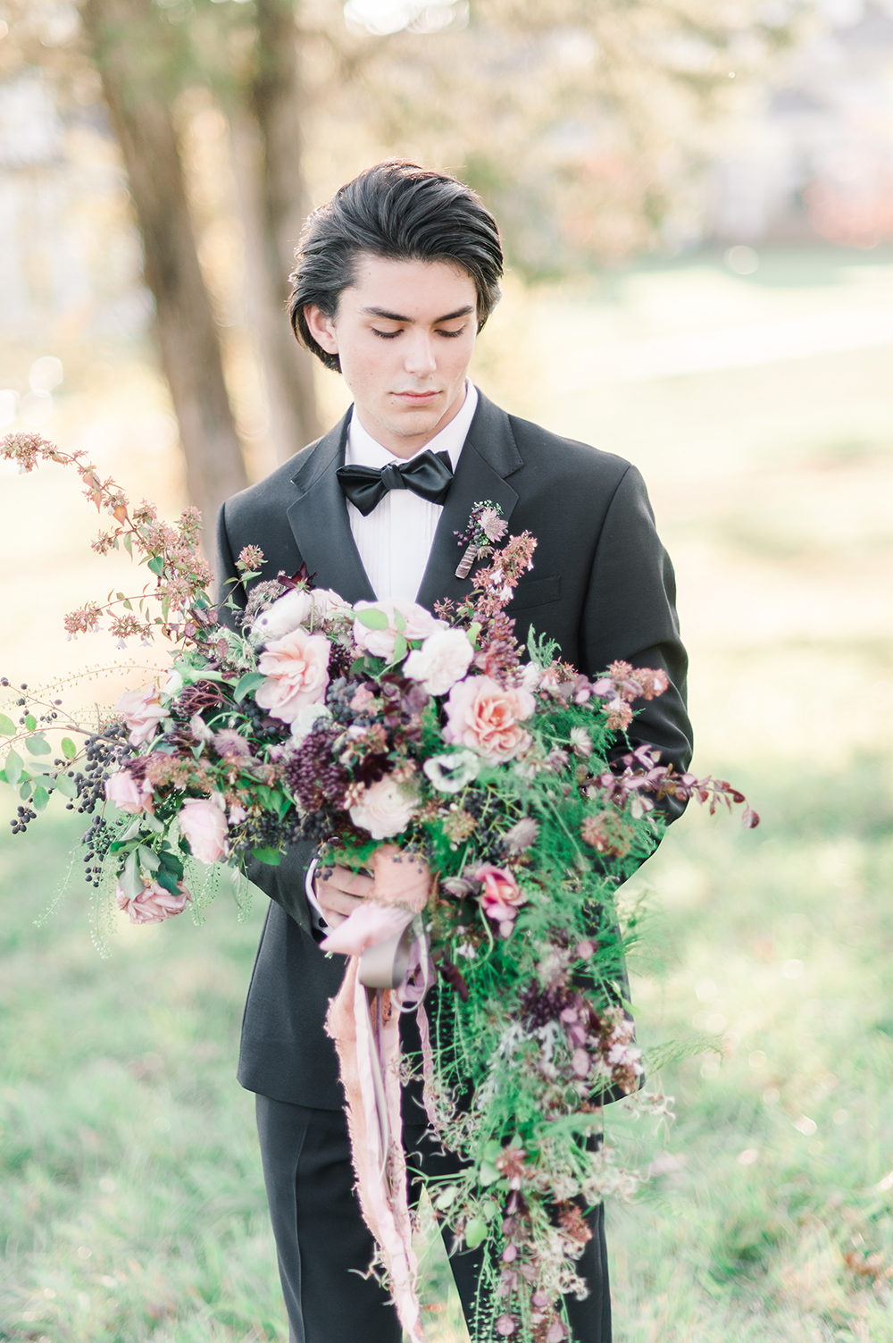 groom with bouquets - photo by Jenny B Photos http://ruffledblog.com/ethereal-wedding-inspiration-with-vintage-accents