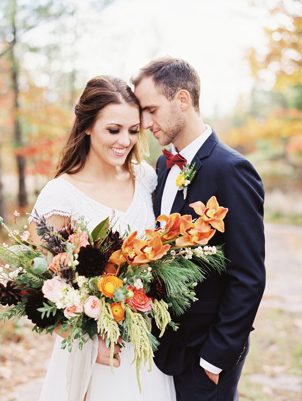 orange wedding bouquets - photo by Evelyn Barkey Photography http://ruffledblog.com/romantic-elopement-inspiration-with-rich-colors