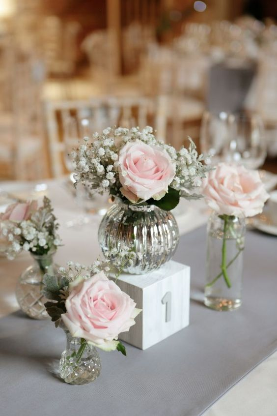 mercury glass vases with blush roses and baby