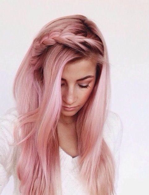 pink straight hair with darker roots and an ombre effect to blonde