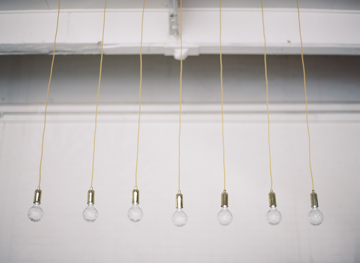 Edison bulb pendant lights - photo by Qlix Photography http://ruffledblog.com/wedding-elegance-with-understated-beauty