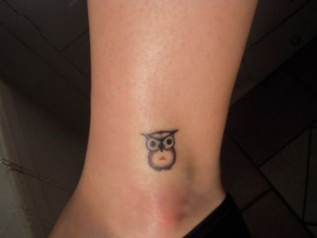Small owl on the leg