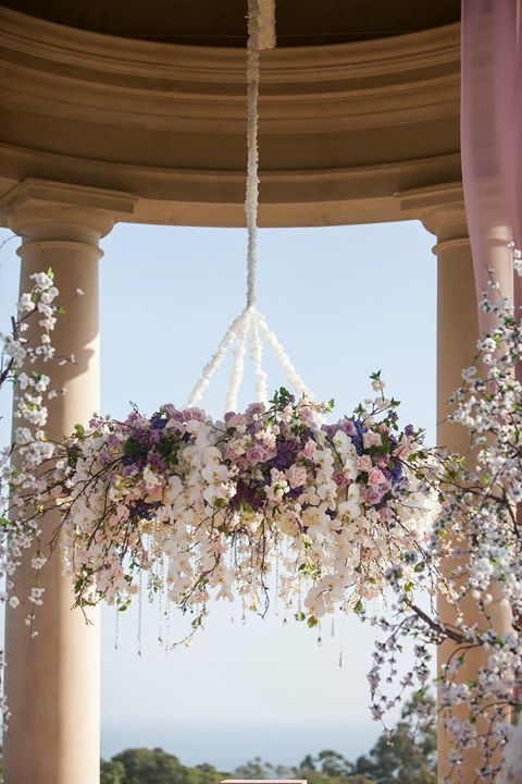 this pastel pink and purple floral chandelier is perfect for a lavish wedding
