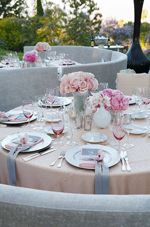 blush tablecloth and roses, grey and pink accents for each place setting