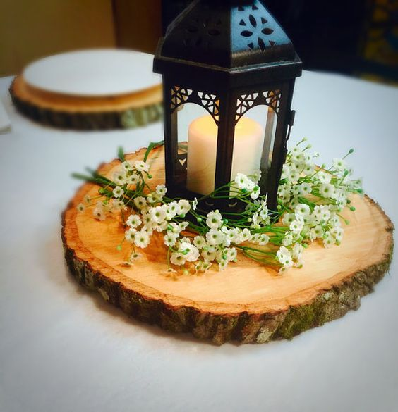 cute and simple centerpiece with a candle lantern and wildflowers