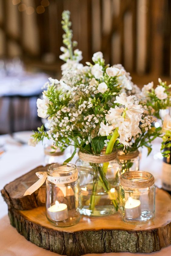 mason jars with ribbons used as candle holders and vases