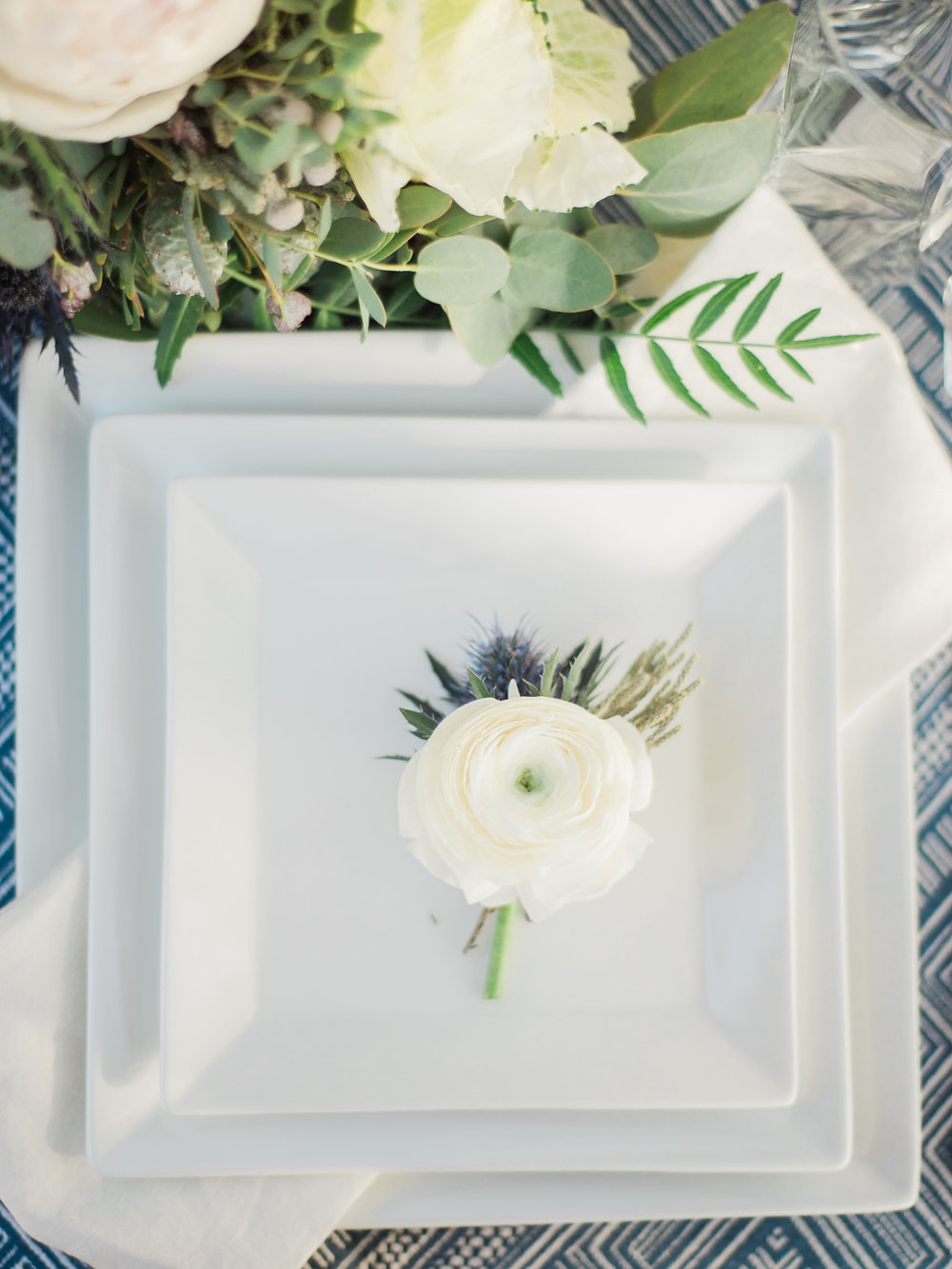 white place settings - photo by Anya Kernes Photography http://ruffledblog.com/organic-wedding-inspiration-with-shades-of-blue