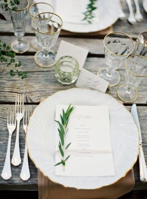 rustic spring table setting with fresh greenery and a wooden table
