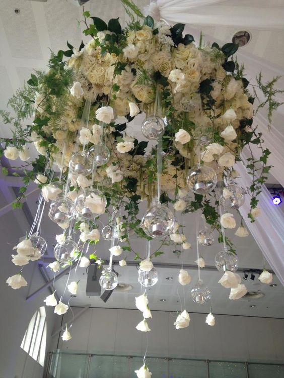 white roses chandelier with hanging candle holders
