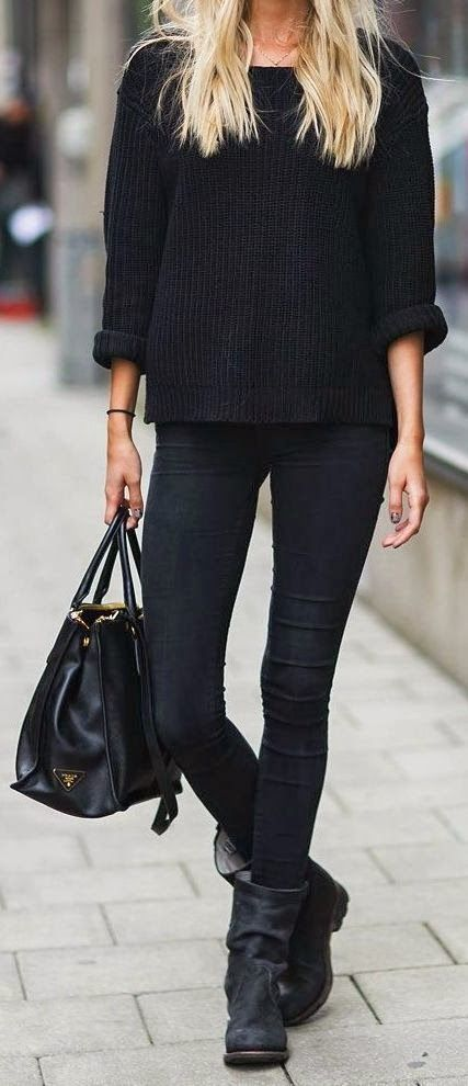 black denim, a chunky knit sweater, flat boots and a tote work well as a winter work outfit