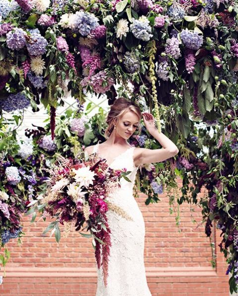 purple and fuchsia wedding arch