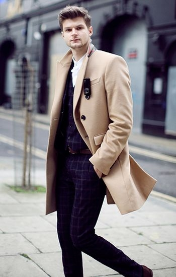 Trench coat over patterned suit