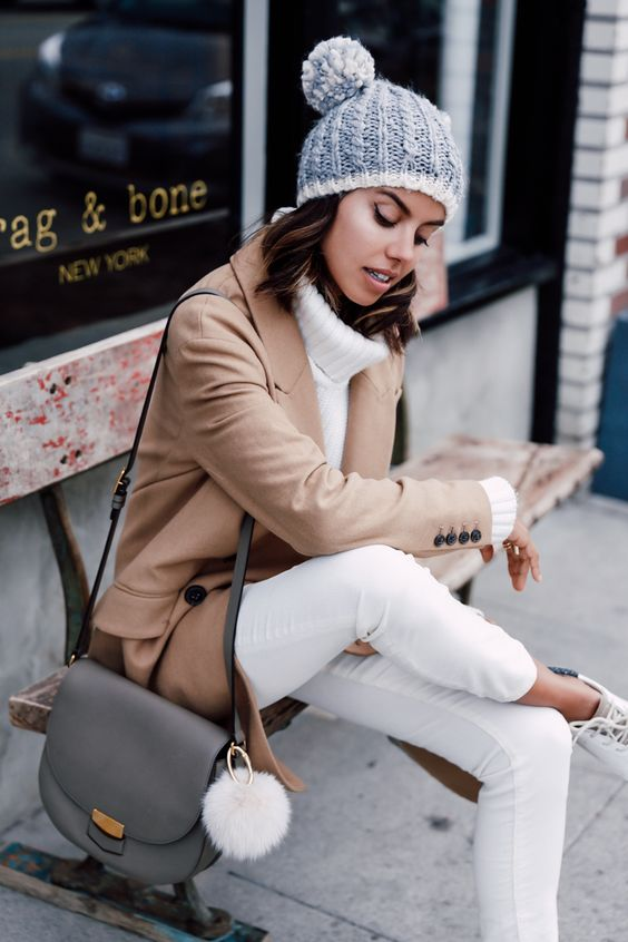 white jeans, a white turtleneck, a brown short coat