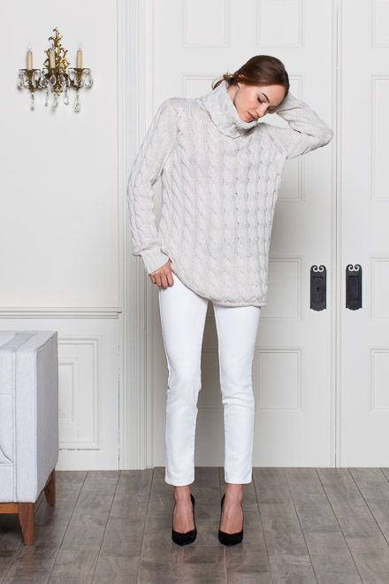 white jeans, black shoes and an oversized cable knit with a turtleneck
