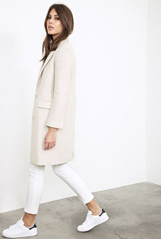 an ivory coat, white jeans and chucks for a comfy look