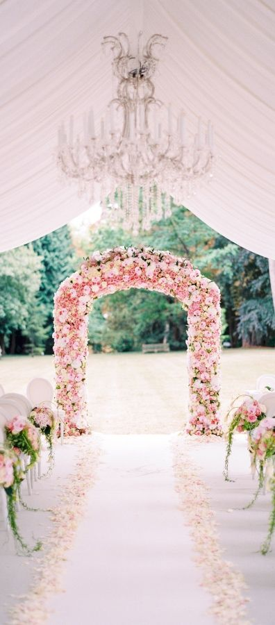 super lush pink floral wedding arch for delicate wedding decor