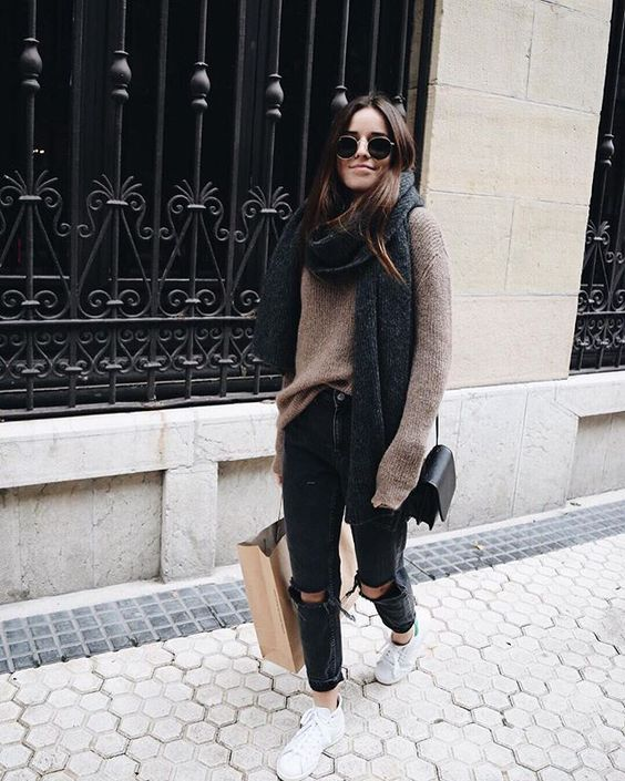 black ripped jeans, a brown oversized sweater and an oversized scarf, sneakers