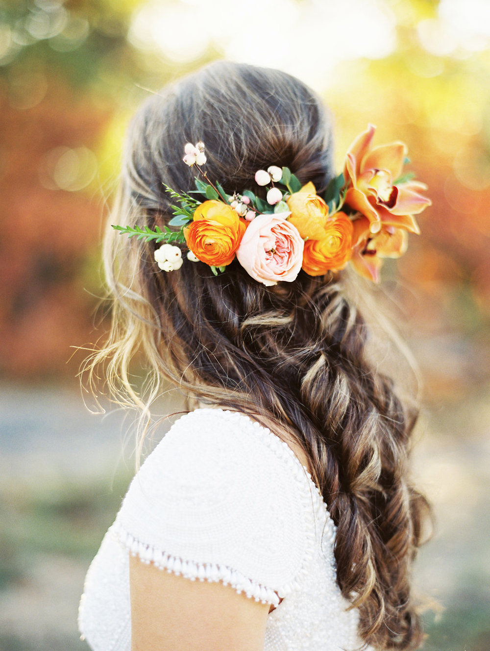 wedding hair with flowers - photo by Evelyn Barkey Photography http://ruffledblog.com/romantic-elopement-inspiration-with-rich-colors