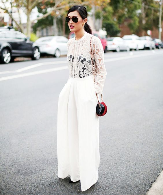 wide pants with a lace top and a black corset